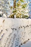 Wooden fence covered with snow Royalty Free Stock Photos