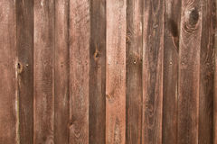 Wooden fence. Dark brown texture background Royalty Free Stock Photos