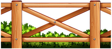 A wooden fence design with plants at the back Royalty Free Stock Photos