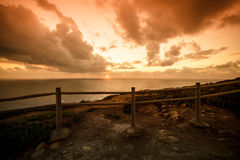 Wooden fence on the edge of Europe. Sunset. tinted Stock Images