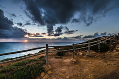 Wooden fence on the edge of Europe. Sunset. tinted.  Stock Image