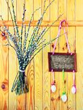 Wooden fence with 'Happy Easter', eggs and willow. Wooden fence with embroidered 'Happy Easter' greeting, eggs and willow stock photos