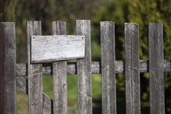 Wooden fence with empty sign board Stock Photos