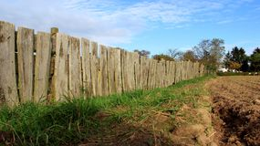 Wooden Fence Of Farming Land. Farming and wooden fence  countryside sunny day with clear sky in Germany Stock Photography