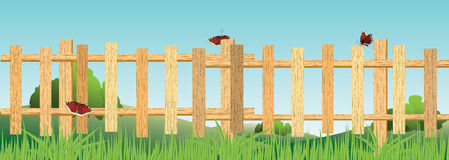 Wooden fence is in the field. Stock Photos