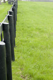 Wooden fence on field Royalty Free Stock Images