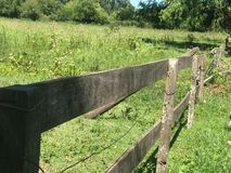 Wooden fence in the field. Broken. somewhere in the village stock photo