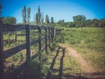 Wooden fence in the field. Broken. somewhere in the village royalty free stock photo