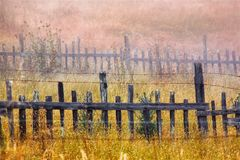 Wooden fence in field. A wooden fence in a field covered with mist, Oregon, USA royalty free stock photos