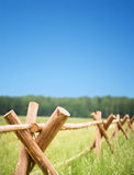 Wooden fence in field Royalty Free Stock Photography