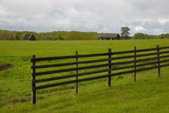 Wooden fence in the field stock images
