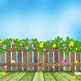 Wooden fence with a flower garland Royalty Free Stock Photo