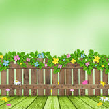 Wooden fence with a flower garland Royalty Free Stock Photos