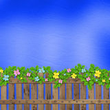 Wooden fence with a flower garland Royalty Free Stock Photography