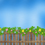 Wooden fence with a flower garland Stock Photo