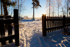 Wooden fence and footpath at winter Royalty Free Stock Photo