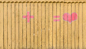 Wooden fence with formula of love Stock Image