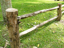 Wooden fence from the fresh real logs Royalty Free Stock Photo