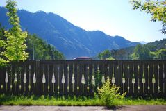 Wooden fence in front of a mountain Royalty Free Stock Image