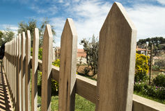 Wooden fence in the garden royalty free stock photography