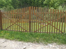 Wooden fence with a gate Royalty Free Stock Photos