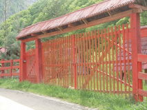 Wooden fence with a gate Stock Images