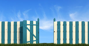 Wooden fence with gate on sky background Royalty Free Stock Photography