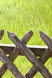 Wooden fence on the grass Royalty Free Stock Photos