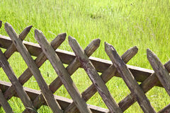 Wooden fence on the grass Stock Images