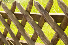 Wooden fence on the grass Royalty Free Stock Image