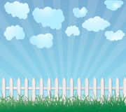 Wooden fence and grass. White wooden fence and green grass under dramatic sky Royalty Free Stock Photos