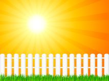 Wooden fence and grass. White wooden fence and green grass under dramatic sky Stock Photography