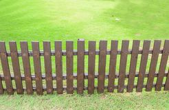 Wooden fence on grass. Royalty Free Stock Photography