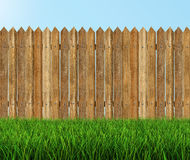Wooden fence on grass (clipping path included) Royalty Free Stock Photos