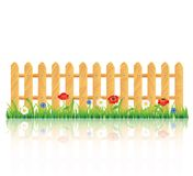 Wooden fence on grass with flowers Royalty Free Stock Photos