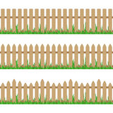 Wooden fence with grass. Royalty Free Stock Image