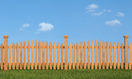 Wooden fence on grass Stock Photos