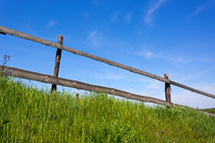 Wooden fence on grassland Royalty Free Stock Image
