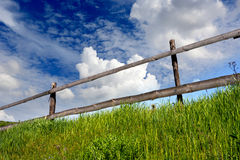 Wooden fence on grassland Royalty Free Stock Photography