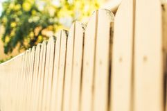 Wooden fence and green background Royalty Free Stock Photos
