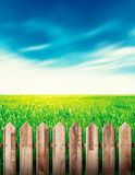 Wooden fence in green field Stock Photography