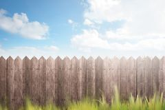 Wooden fence on green garden stock photography