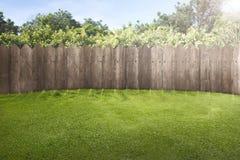 Wooden fence on green garden stock photo