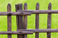 Wooden fence and green grass Stock Photo
