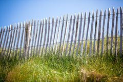 Wooden fence, Green Grass and Blue Sky Royalty Free Stock Photography