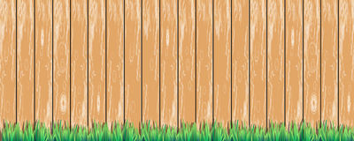 Wooden fence with green grass at the bottom Royalty Free Stock Photography