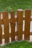 Wooden fence and green grass Royalty Free Stock Photos
