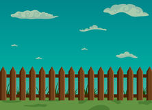 Wooden fence and green grass with sky Royalty Free Stock Image