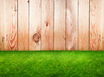 Wooden fence in a green grass Stock Image