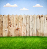 Wooden fence in a green grass Royalty Free Stock Image